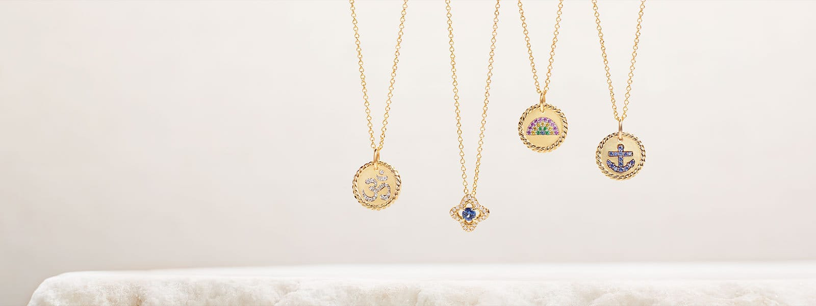Cable Collectibles® and Venetian Quatrefoil necklaces in 18K yellow gold with diamonds and sapphires.