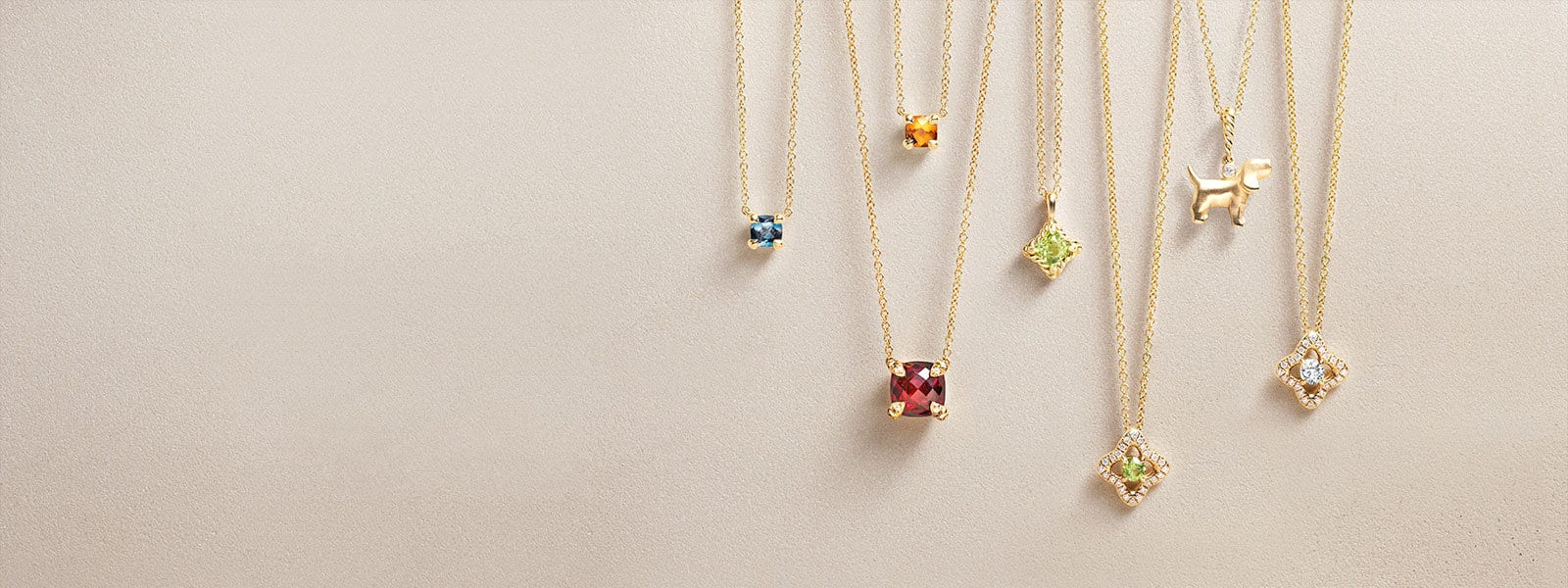 Cable Kids® Châtelaine® necklaces in 18K yellow gold with Hampton blue topaz, citrine and peridot. Cable Collectibles® charm necklace in 18K yellow gold with diamonds. Châtelaine® and Venetian Quatrefoil necklaces in 18K yellow gold with garnet, diamonds and peridot.