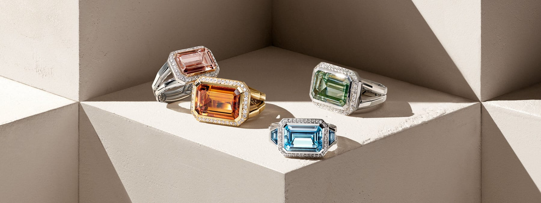 David Yurman Novella rings in 18K yellow gold with citrine and diamonds, and sterling silver with blue topaz, prasiolite and morganite.