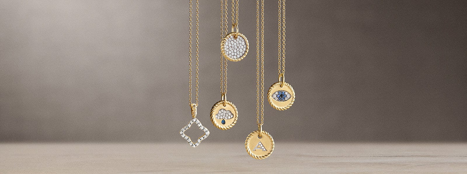 Cable Collectibles® charm necklaces in 18K yellow gold with diamonds and sapphires.