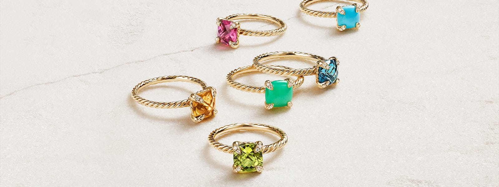 Châtelaine® rings in 18K yellow gold with colored gemstones and pavé diamonds.