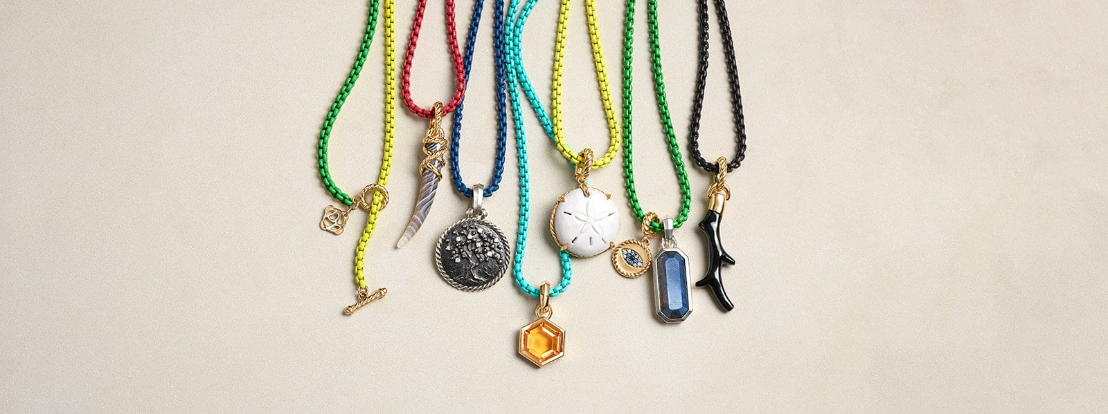 DY Bel Aire chains a variety of colors with multiple amulets set with colored gemstones.