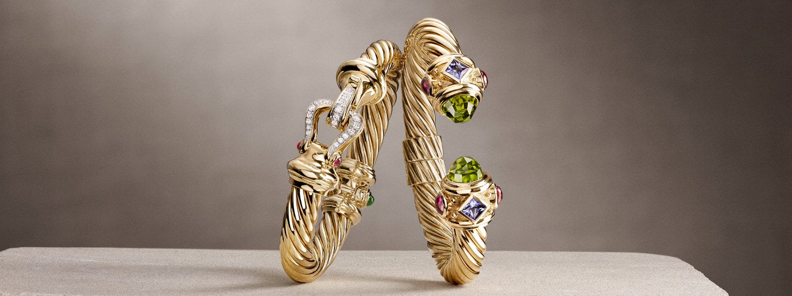 A Cable Buckle Collection® and Renaissance Collection bracelet in 18K yellow gold with diamonds and colored gemstones.