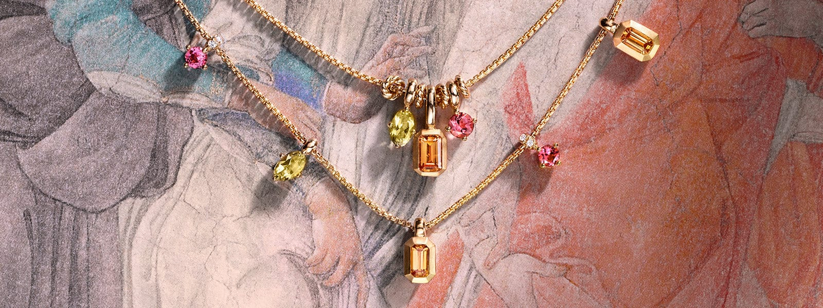 Novella necklaces in 18K yellow gold with colored gemstones and white diamonds against a Renaissance-style painting.