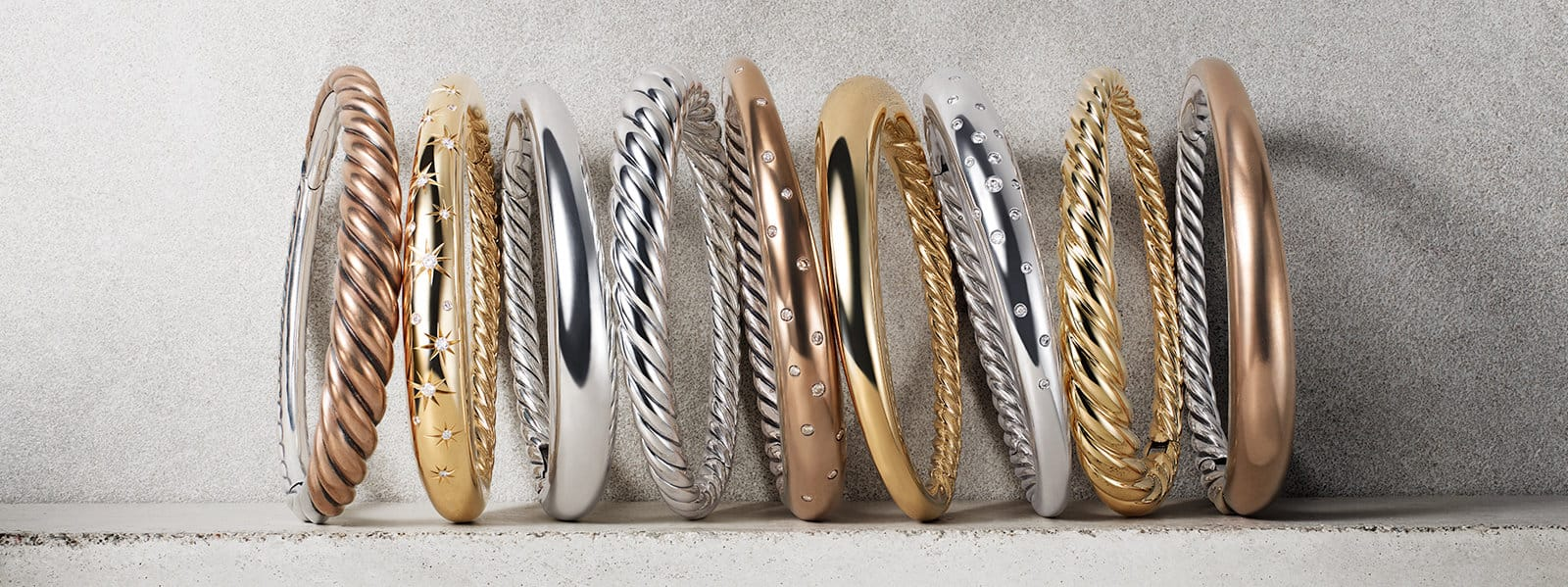 Pure Form® bracelets in bronze, 18K yellow gold and sterling silver with and without diamonds.