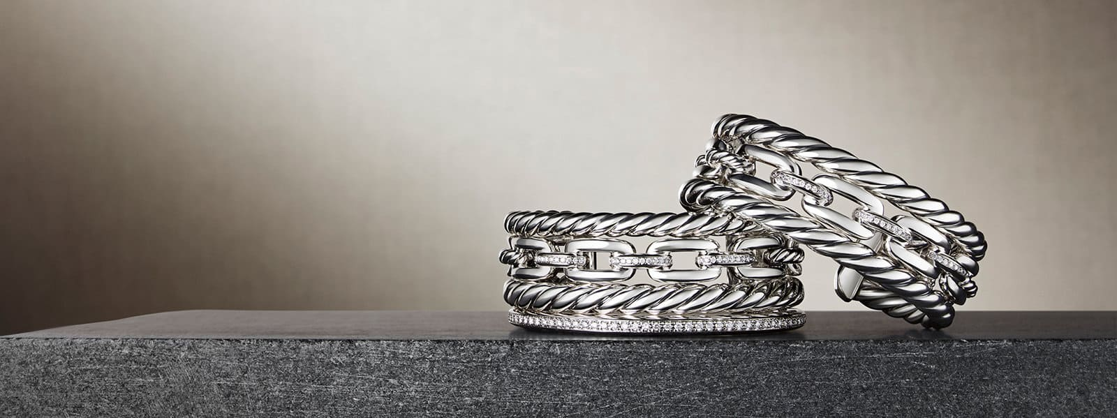 Wellesley Link™ cuffs in sterling silver with diamonds on a stone.