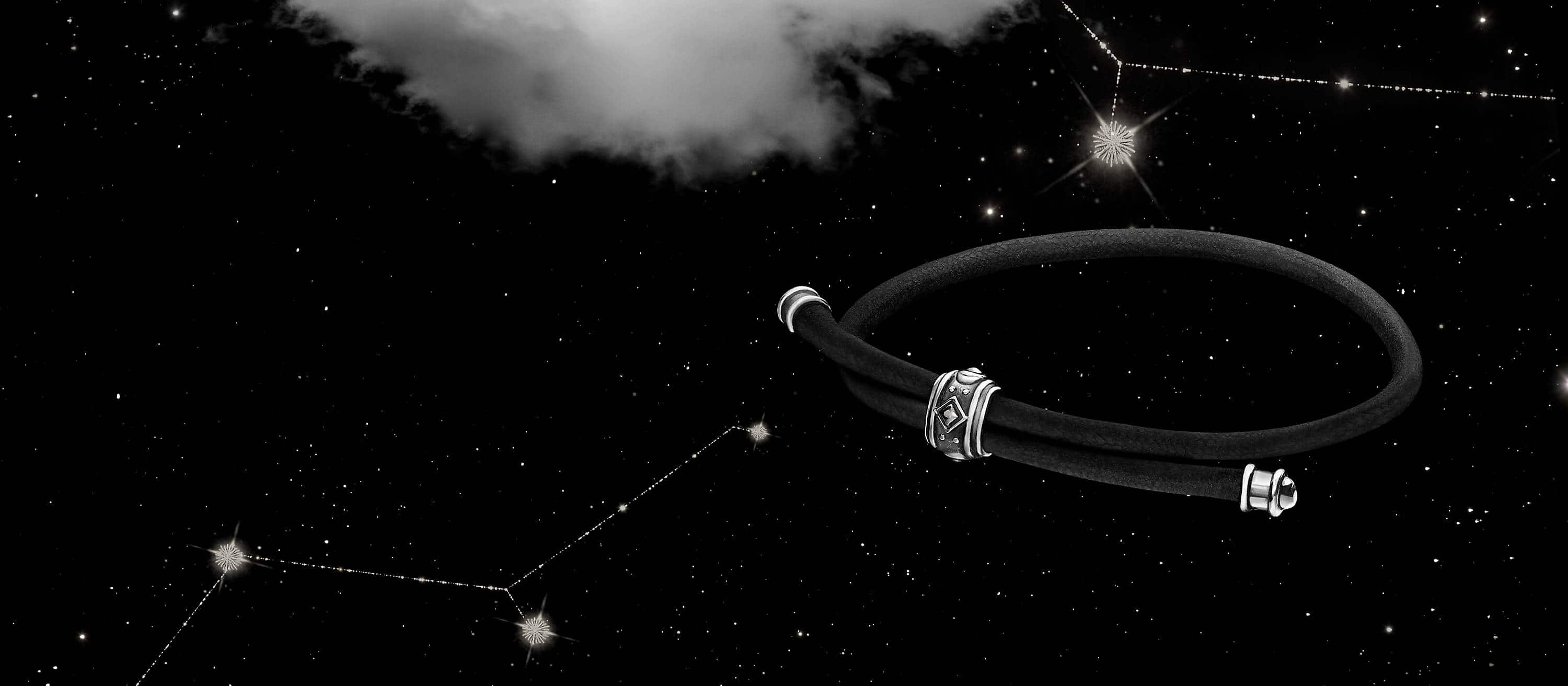 A color photo shows a renaissance corded bracelet on a white cloud in a starry night sky.