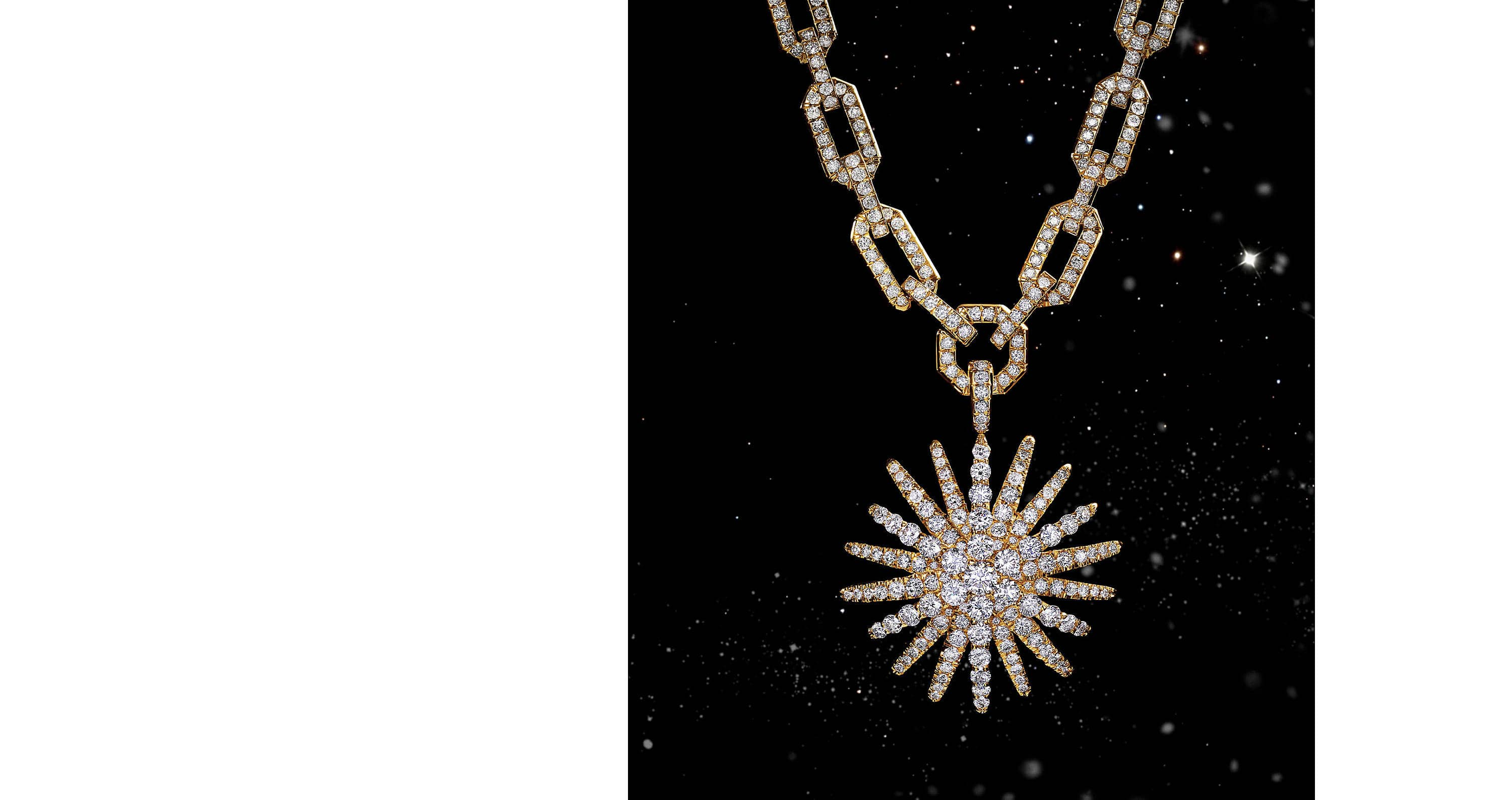 Inspired by bursts of light in the night sky, this magnificent pendant is hand set with 3.42 carats of diamonds using a mix of styles.