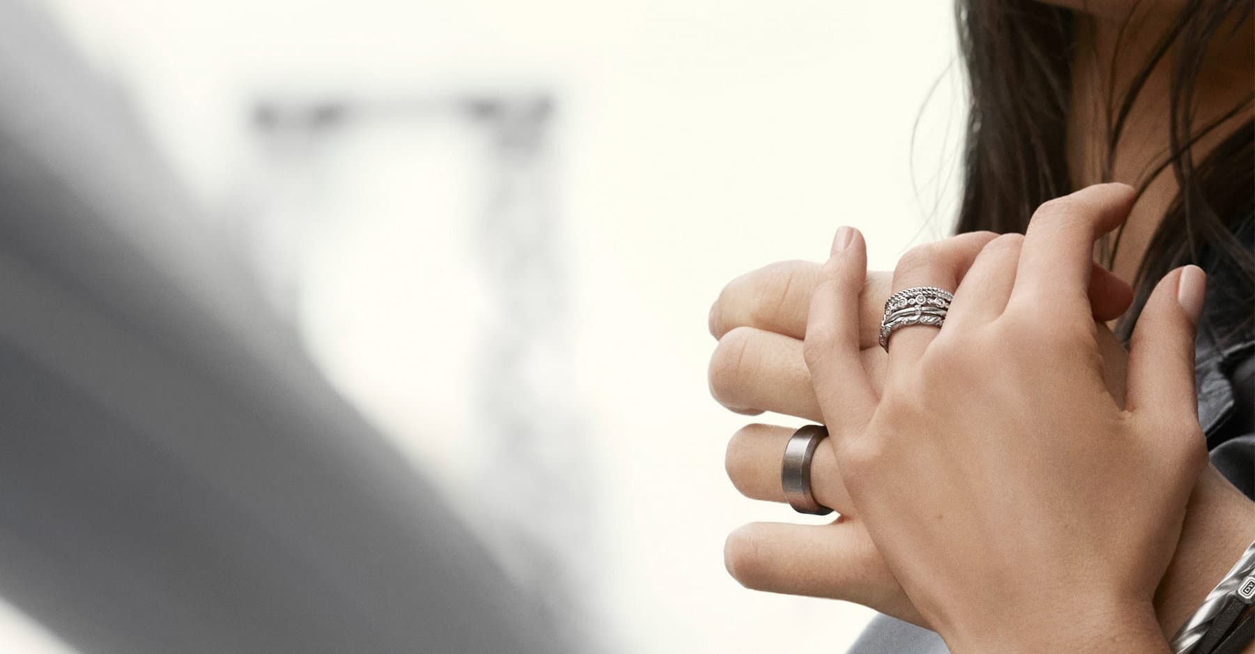 A color photo shows a man and woman holding hands. They each wear an assortment of David Yurman designs.
