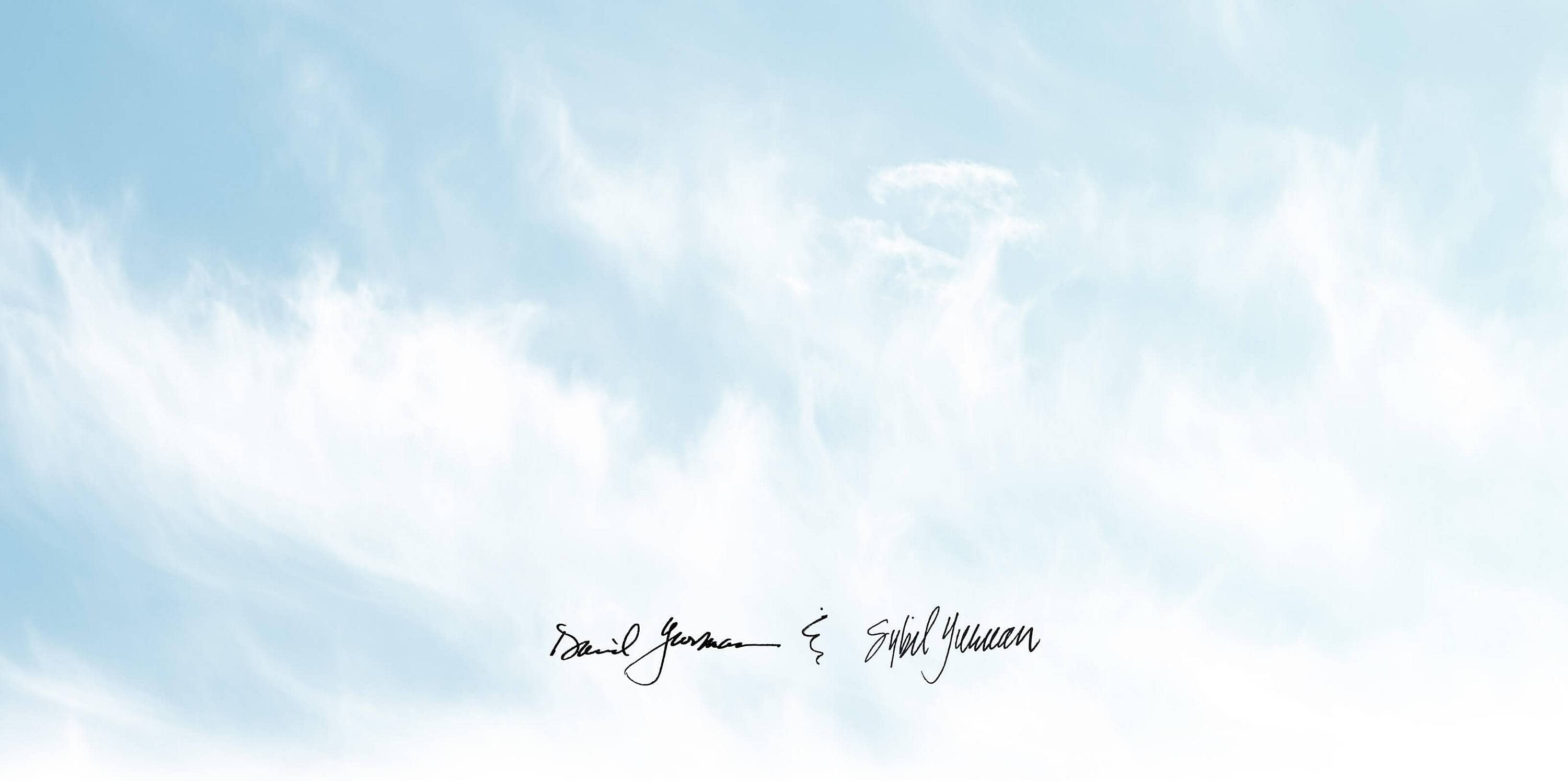 A photo shows a bright-blue sky filled with wispy clouds and David and Sybil Yurman's handwritten signatures in black ink below the introduction copy on the page.